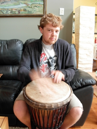 Jordan playing the Djembe. (Photo © Kim Goldberg)