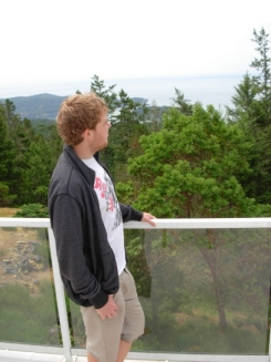 From his balcony, Jordan surveys the rugged rural terrain of East Sooke, and the Juan de Fuca Strait beyond. (Photo © Kim Goldberg 2013)