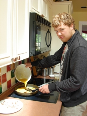Jordan cooks us up an omelette with his special sauce. (Photo © Kim Goldberg 2013)