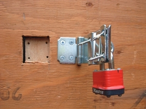 BC Hydro ripped the woodscrews out of the plywood barricade to get past the padlock just one month after BC Energy Minister Bill Bennett said no one would be forced to have a smart meter against their will. (Photo © Kim Goldberg)
