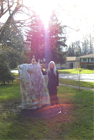 Lucy's new partner, geomancer Alan Reed, gave her a 3,000-pound quartz crystal, strategically placed on a beneficial underground water crossing on her front lawn. Some will say the unexpected column of light engulfing Lucy in this photo is just lens flare. Lucy sees it differently.